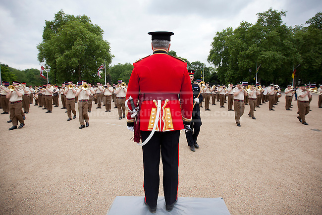 10/06/2013. London, UK. The Senior Director of Music, Lieutenant Colonel Stephen Barnwell, who will retire this year after 38 years in military music, conducts the Massed Bands of the British Army's Household Division as they carry out a dress rehearsal ahead of the annual Beating Retreat ceremony in London today (10/06/2013). The musical event, which takes place on Horse Guards Parade, will be held on the 12th and 13th of June this year, with Prince Philip and the Queen attending. Photo credit: Matt Cetti-Roberts