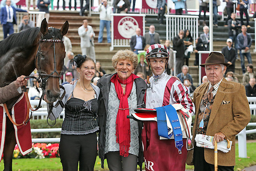 06.10.2012. Longchamps Racecourse, France.   Cirrus the Aigles with Olivier Peslier and team manager Corine  Barbe After Winning The Qatar Prix Dollars Longchamp Racecourse