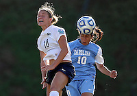 SAN DIEGO, CA - DECEMBER 02, 2012:  Ranee Premji (10) of the University of North Carolina heads away from Christine Nairn (10) of Penn State University during the NCAA 2012 women's college championship match, at Torero Stadium, in San Diego, CA, on Sunday, December 02 2012. Carolina won 4-1.