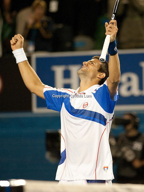 January 27, 2011.Novak Djokovic of Serbia, celebrates after defeating Roger Federer of Switzerland, in the semi-final at the Australian Open,Rod Laver Stadium, Melbourne Park, Melbourne, Australia.
