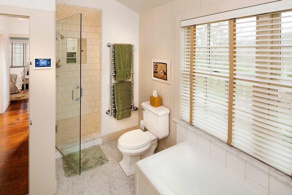 Want to play music while you're in the shower? Not a problem with this Control 4 touch panel and hidden speakers.