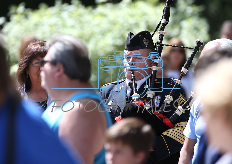 Sgt. 1st Class Michael Connell plays the Army Song at the 2016 Flag Day &amp; Army Birthday ceremony at the Capitol in Carson City, Nev., on Tuesday, June 14, 2016.<br />Photo by Cathleen Allison