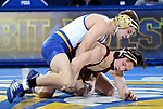 BROOKINGS, SD - NOVEMBER 17: Seth Gross from South Dakota State battles with Mitch Mckee from the University of Minnesota during their 133 pound match Friday evening at First Arena in Brookings, SD.  (Photo by Dave Eggen/Inertia)
