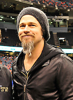 """NFL Saints -Actor Brad Pitt and his adopted son Maddox walk on the New Orleans Saints side line before the NFC playoff game between the Saints and the Cardinals Saturday jan. 16, 2010 in Louisiana at the SuperDome. Brad has been instrumental in rebuilding the lower ninth ward in New Orleans through his Make it Right non profit that is building """"green homes"""" where Hurricane Katrina destroyed everything. The Saints beat the Cardinals to advance in the playoffs. Photo ©Suzi Altman/Suzisnaps.comNFL Saints -Cardinals playoffs. Photo ©Suzi Altman/Suzisnaps.comNFL Saints -Cardinals playoffs. Photo ©Suzi Altman/Suzisnaps.com"""