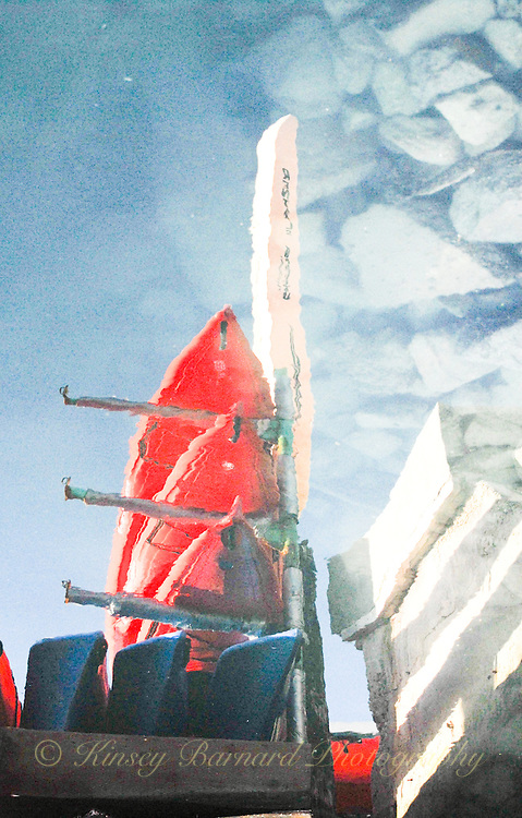 &quot;RED KAYAKS &amp; ROCKY BLUE SKIES&quot;<br /> <br /> Red sea kayaks stacked in a rocky blue sky but it's all a reflection.