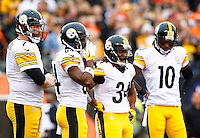 Ben Roethlisberger #7 of the Pittsburgh Steelers huddles with his teammates in the first quarter against the Cincinnati Bengals during the game at Paul Brown Stadium on December 12, 2015 in Cincinnati, Ohio. (Photo by Jared Wickerham/DKPittsburghSports)