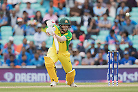 David Warner (Australia) pushes into the off side during India vs Australia, ICC World Cup Cricket at The Oval on 9th June 2019