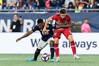 FOXBOROUGH, MA - AUGUST 25: DeJuan Jones #24 of New England Revolution and Przemyslaw Frankowski #11 of Chicago Fire battle for the ball during a game between Chicago Fire and New England Revolution at Gillette Stadium on August 24, 2019 in Foxborough, Massachusetts.