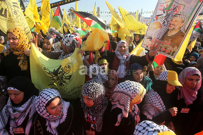 Tens of thousands of Palestinians marched Friday carrying yellow banners of Palestinian President Mahmoud Abbas' Fatah party during celebrations marking the 48th anniversary of the Fatah movement in Gaza City, Friday, Jan. 4, 2013. Fatah is staging its first rally in the Islamist Hamas-controlled Gaza Strip since 2007, reflecting warming ties between the two rival factions. Photo by Ashraf Amra
