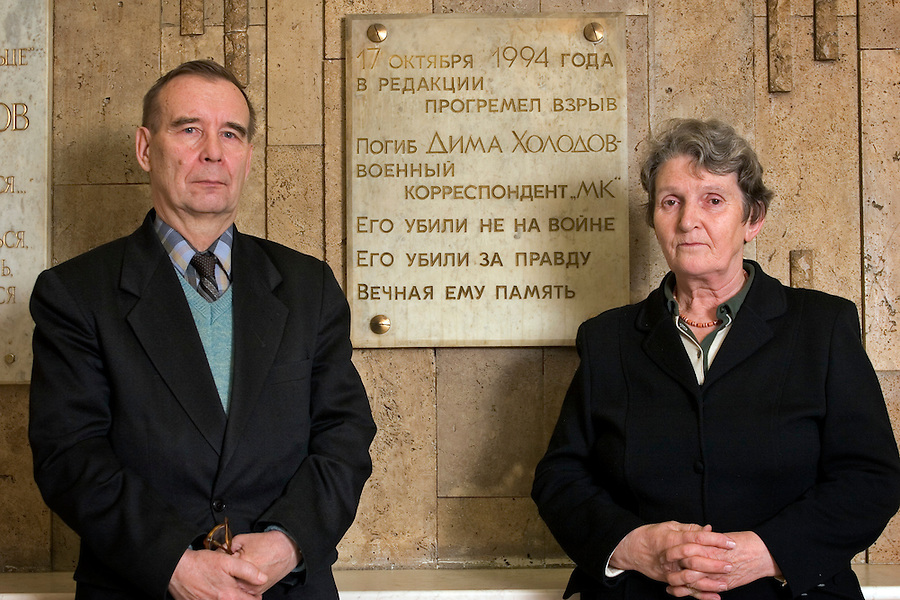 """Moscow, Russia, 22/11/2005..Yuri Viktorivich and Zoya Alexandrovna, father and mother of Dimitri Kholodkov, in the offices of Moskovskii Komsomolyets newspaper. Dimitri Kholodkov was a MK war correspondent killed in a 1994 explosion in the newsroom when he opened a booby-trapped briefcase which he believed contained evidence of corruption in the Russian Army. The plaque reads:.On October 17th 1994 there was an explosion in the editorial office and Dima Kholodov, military reporter of MK, was killed. He was not killed at the war. He perished for telling the truth. May his memory live forever."""""""