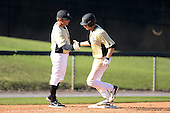 Central Florida Knights infielder Tommy Williams (14) congratulated by coach Kevin Schnall (9) after hitting a home run during a game against the Siena Saints at Jay Bergman Field on February 16, 2014 in Orlando, Florida.  UCF defeated Siena 9-6.  (Copyright Mike Janes Photography)