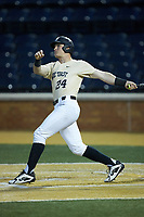 Chris Lanzilli (24) of the Wake Forest Demon Deacons follows through on a 2-run home run against the Liberty Flames at David F. Couch Ballpark on April 25, 2018 in  Winston-Salem, North Carolina.  The Demon Deacons defeated the Flames 8-7.  (Brian Westerholt/Four Seam Images)