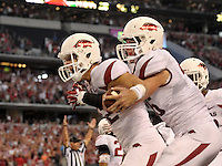 STAFF PHOTO BEN GOFF  @NWABenGoff -- 09/27/14 Arkansas tight end Alex Voelzke, right, congratulates punter Sam Irwin-Hill after ran a touchdown on a trick play during the second quarter in the Southwest Classic in AT&T Stadium in Arlington, Texas on Saturday September 27, 2014.