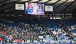 Barrie McKay towers over the Celtic support as they make their way out of the stadium
