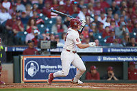 Justin Mitchell (14) of the Oklahoma Sooners follows through on his swing against the Arkansas Razorbacks in game two of the 2020 Shriners Hospitals for Children College Classic at Minute Maid Park on February 28, 2020 in Houston, Texas. The Sooners defeated the Razorbacks 6-3. (Brian Westerholt/Four Seam Images)