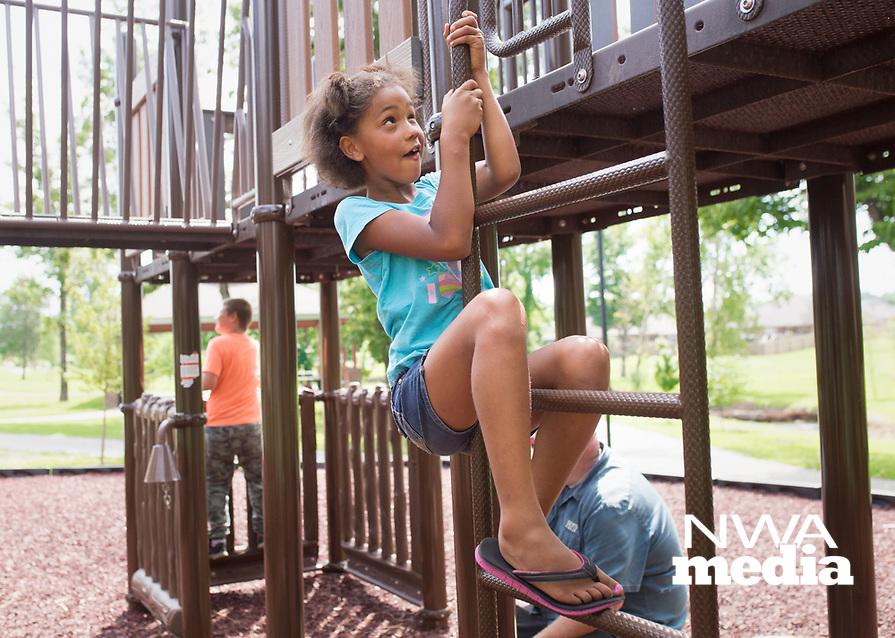 NWA Democrat-Gazette/CHARLIE KAIJO Riley Fuller, 8, of Centerton plays, Monday, August 5, 2019 at McKissic Springs Station playground in Centerton.