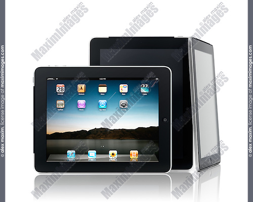 Three Apple iPad 3G tablet computers in a composition isolated on white background