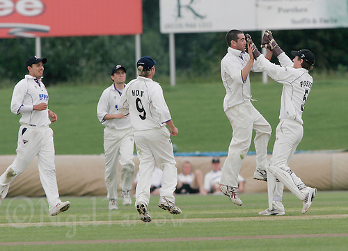 15 JUN 2006 - DERBY, UK - Damian Shirazi and Ed Foster celebrate the dismissal of Danny Pratt during the British Universities Mens Cricket Championship Final. (PHOTO (C) NIGEL FARROW)