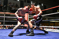 Connor Vian (white/red shorts) defeats Ricky Rose during a Boxing Show at York Hall on 14th April 2018