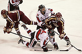 Blake Bolden (BC - 10),Claire Santostefano (NU - 13), Casey Pickett (NU - 14), Emily Field (BC - 15) - The Northeastern University Huskies defeated Boston College Eagles 4-3 to repeat as Beanpot champions on Tuesday, February 12, 2013, at Matthews Arena in Boston, Massachusetts.