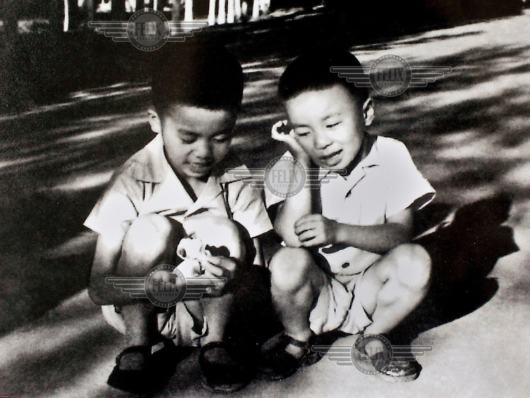 A photograph from the family album of artist Ai Wei Wei showing him as a child (right).