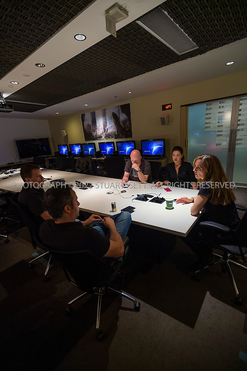 9/19/2012--Kirkland, WA, USA..Halo's offices in Kirkland, WA, across Lake Washington from Seattle. Here, Bonnie Ross (right) is a general manager and studio head of 343 Industries leads a meeting with Kiki Wolfkill (2nd right), Frank O'Connor (3rd right), Josh Holmes (far left) and Dan Ayoub  (front left)...Halo is a multi-billion dollar science fiction video game franchise created by Bungie and now managed by 343 Industries and owned by Microsoft Studios. The series centers on an interstellar war between humanity and a theocratic alliance of aliens known as the Covenant (Source: WIKIPEDIA). A new installment in a second trilogy of games, Halo 4, is scheduled for release on November 6, 2012...©2012 Stuart Isett. All rights reserved.