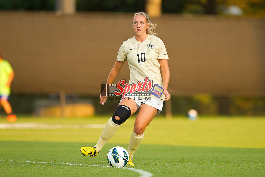 Kim Marshall (10) of the Wake Forest Demon Deacons passes the ball during first half action against the UNCG Spartans at Spry Soccer Stadium on August 24, 2012 in Winston-Salem, North Carolina.  The Spartans defeated the Demon Deacons 1-0.  (Brian Westerholt / Sports On Film)