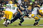 Seattle Seahawks defensive end  Cassius Marsh (91) attempts to tackle  Green Bay Packers running back Eddie Lacy (27) in the  NFL Kickoff Game game at CenturyLink Field in Seattle, Washington on September 4, 2014.  Seattle beat Green Bay 36-16. ©2014  Jim Bryant Photo. ALL RIGHTS RESERVED.