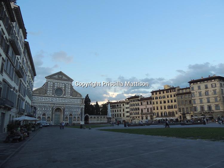 Florence, Italy - October 1, 2012: The sun sets behind the Basilica of Santa Maria Novella.