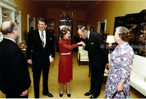 Joseph M.A.H. Luns, Secretary General of the North Atlantic Treaty Organization (NATO), right center, greets first lady Nancy Reagan, center, while United States President Ronald Reagan, left center, welcomes Elisabeth Borgman-Brouwer, Presonal Assistant to Mr. Luns, right, and Paul van Campen, Cabinet Director, left, at the White House in Washington, D.C. on Thursday, April 16, 1981.<br /> Mandatory Credit: Michael Evans - White House via CNP