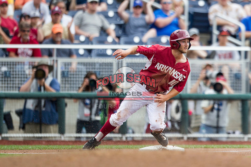 Arkansas Razorbacks outfielder Joe Serrano (10) stops at third base against the Virginia Cavaliers in Game 1 of the NCAA College World Series on June 13, 2015 at TD Ameritrade Park in Omaha, Nebraska. Virginia defeated Arkansas 5-3. (Andrew Woolley/Four Seam Images)