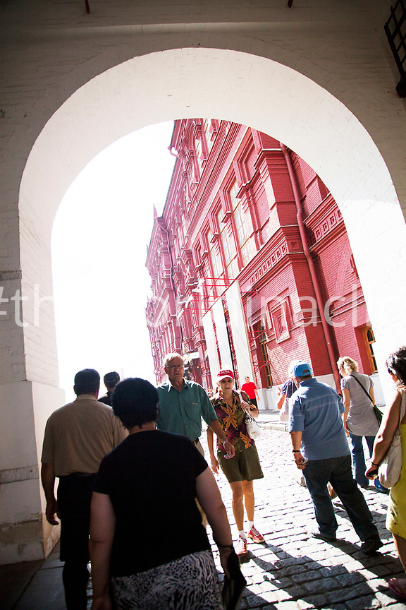 RUSSIA, Moscow. Tourist and locals walking into Red Sqaure.