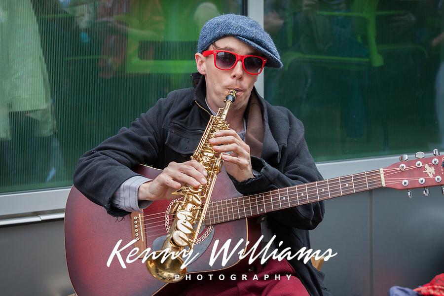 Musician playing flute and guitar, Northwest Folklife Festival 2016, Seattle Center, Washington, USA.