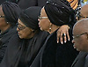 WINNIE MANDELA(Nelson's former wife) HUGS HIS WIDOW GRACA MACHEL<br /> as Mandela's body arrives at Mthatha Airport before its is transported to his burial at his home in Qunu, Eastern Cape, South Africa_14/12/2013<br /> Mandatory Credit Photo: &copy;NEWSPIX INTERNATIONAL<br /> <br /> **ALL FEES PAYABLE TO: &quot;NEWSPIX INTERNATIONAL&quot;**<br /> <br /> IMMEDIATE CONFIRMATION OF USAGE REQUIRED:<br /> Newspix International, 31 Chinnery Hill, Bishop's Stortford, ENGLAND CM23 3PS<br /> Tel:+441279 324672  ; Fax: +441279656877<br /> Mobile:  07775681153<br /> e-mail: info@newspixinternational.co.uk