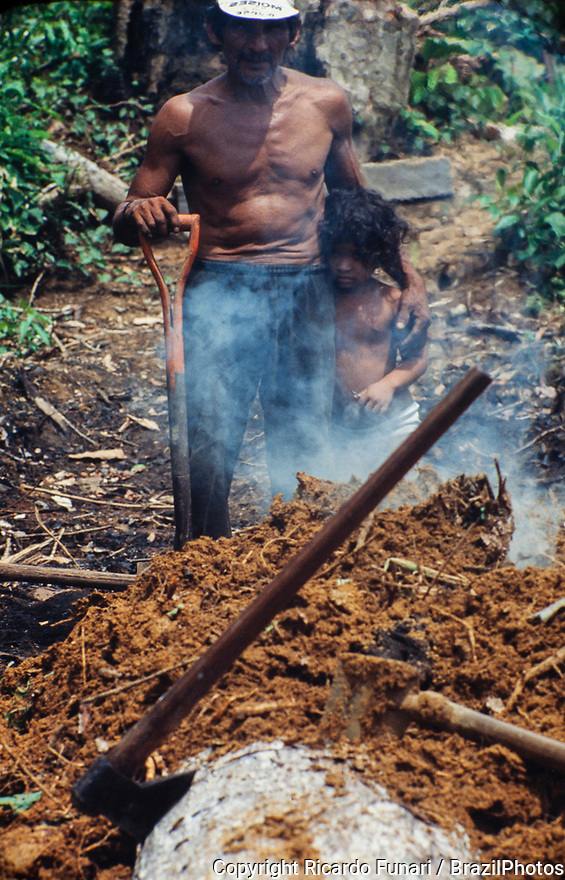 Degrading labor, family work, sawdust burning at sawmill Rio Branco, Acre State - Amazon deforestation, Brazil.