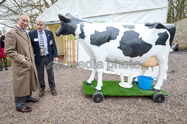 01 February 2016 - London, England - Prince Charles The Prince of Wales is introduced to a plastic cow by Send a Cow ambassador Mark Hillman (right) at the international development charity's headquarters in Newton St Loe, Bath. Send a Cow works in seven countries in Africa, providing some of the continent's poorest people with training, tools, seeds and livestock to help lift themselves out of poverty. Photo Credit: Alpha Press/AdMedia