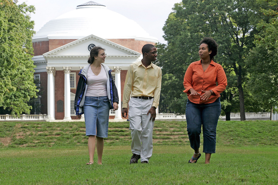 Second year UVa student Jade Craig, middile,  walks with 4th year student Kat Shea, left, and  4th year student Amey Adkins, right, on the lawn area of the University of Virginia in Charlottesville, Va. Photo/Andrew Shurtleff