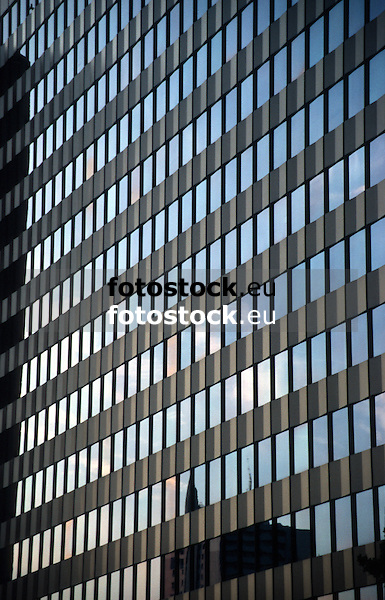 Reflection of sky at dawn in modern glass facade<br />