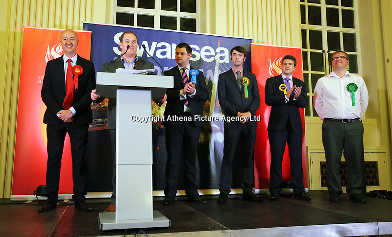 Pictured: Returning officer Huw Evans (2nd L) with the Swansea West candidates.  Friday 09 June 2017<br /> Re: Counting of ballots at Brangwyn Hall for the general election in Swansea, Wales, UK