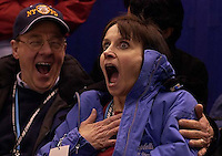 Sarah Hughes's parents John and Amy Hughes can't believe their daughter won the gold medal. Reaction as the medal ceremony takes place. Ladies Free Skating competition, Thursday evening at the Salt Lake Ice Center, 2002 Olympic Winter Games.&amp;#xA; 02.21.2002, 9:54:59 PM<br />