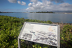 Pearl Harbor Interpretive Panel With USS Arizona And The USS Missouri In The Background