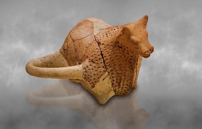 Hittite terra cotta sleremonial libation rhython in the shape of a bull. Hittite Period, 1600 - 1200 BC.  Hattusa Boğazkale. Çorum Archaeological Museum, Corum, Turkey. Against a grey bacground.