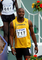Asafa Powell of Jamaica view the result board after his 1st. round heat in the 100m dash with a time of 10.34sec. at the 11th. IAAF World Championships held in Osaka, Japan on Saturday, August 25, 2007. Photo by Errol Anderson,The Sporting Image.