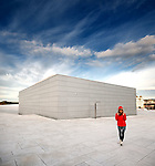 Unknown girl walk on Oslo Opera roof at 6 am