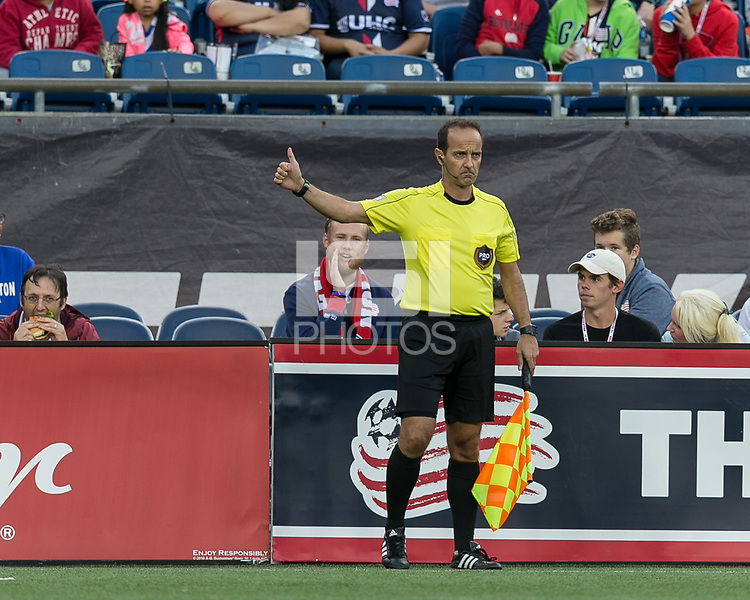 Foxborough, Massachusetts - October 15, 2017: In a Major League Soccer (MLS) match, New England Revolution (blue/white) defeated New York City FC (light blue/blue), 2-1, at Gillette Stadium.<br /> Assistant referee Claudiu Badea indicates ready to go.