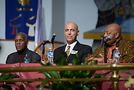 Washington, DC - January 11, 2014: Businessman and D.C. mayoral candidate Andy Shallal (c) holds a community forum with Actor Danny Glover (l) in advance of the April primary. Rev. Willie F. Wilson (r) hosted the forum at the Union Temple Baptist Church.  (Photo by Don Baxter/Media Images International)