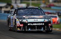 Aug. 8, 2009; Watkins Glen, NY, USA; NASCAR Sprint Cup Series driver Bobby Labonte during practice for the Heluva Good at the Glen. Mandatory Credit: Mark J. Rebilas-
