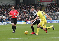 Referee John Beaton watching Cammy Smith on the ball in the St Mirren v Livingston Scottish Professional Football League Ladbrokes Championship match played at the Paisley 2021 Stadium, Paisley on 14.4.18.