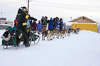 Jeff King is greeted by Kaltag residents as he arrives @ village in first place 2006 Iditarod Alaska