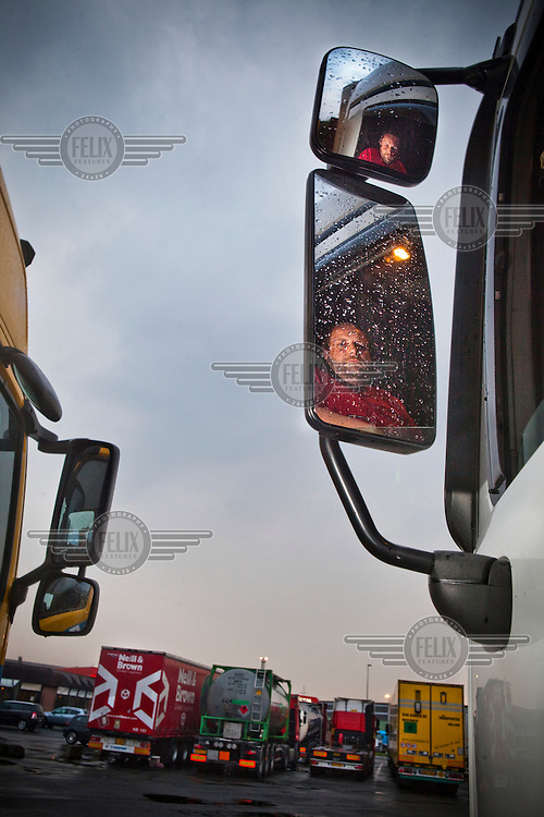 A Swiss truck driver parks his vehicle in the truck park in the port of Antwerp.
